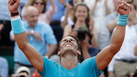 Spain's Rafael Nadal celebrates winning the men's final match of the French Open tennis tournament against Austria's Dominic Thiem in three sets 6-4, 6-3, 6-2, at the Roland Garros stadium in Paris, France, Sunday, June 10, 2018. (AP Photo/Alessandra Tarantino)