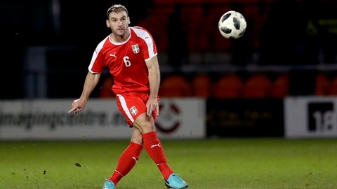 In this photo taken on Tuesday, March 27, 2018, Serbia's Branislav Ivanovic kicks the ball during the international friendly soccer match between Serbia and Nigeria at The Hive Stadium in London. (AP Photo/Matt Dunham)