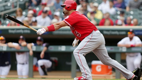 Los Angeles Angels' Albert Pujols hits a two-run RBI against the Minnesota Twins in the first inning of a baseball game Sunday, June 10, 2018, in Minneapolis. (AP Photo/Andy Clayton-King)