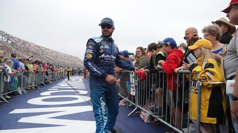 Driver Martin Truex Jr. greets fans during driver introductions before a NASAR Cup Series auto race, Sunday, June 10, 2018, in Brooklyn, Mich. (AP Photo/Carlos Osorio)