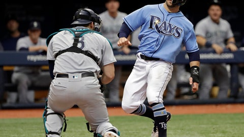 Seattle Mariners catcher Mike Zunino, left, tags out Tampa Bay Rays' Johnny Field, right,  as Field was trying to score on a single by Carlos Gomez during the ninth inning of a baseball game Sunday, June 10, 2018, in St. Petersburg, Fla. (AP Photo/Chris O'Meara)