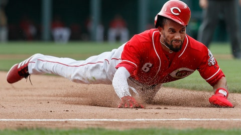 Cincinnati Reds' Billy Hamilton slides into third to advance on a wild pitch by starting pitcher Carlos Martinez in the fourth inning of a baseball game, Sunday, June 10, 2018, in Cincinnati. (AP Photo/John Minchillo)