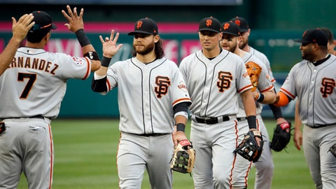 San Francisco Giants' Gorkys Hernandez (7), San Francisco Giants shortstop Brandon Crawford, second from left, and others celebrate after a baseball game against the Washington Nationals at Nationals Park, Sunday, June 10, 2018, in Washington. The Giants won 2-0. (AP Photo/Alex Brandon)