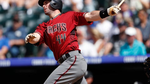 Arizona Diamondbacks' Paul Goldschmidt follows the flight of his triple to drive in two runs off Colorado Rockies relief pitcher Jerry Vasto in the seventh inning of a baseball game Sunday, June 10, 2018, in Denver. (AP Photo/David Zalubowski)