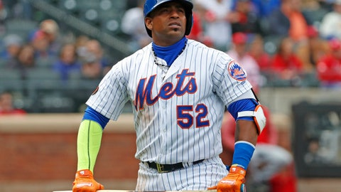 FILE - In this Sunday, April 1, 2018 file photo, New York Mets Yoenis Cespedes (52) holds his broken bat as he looks at a video replay of his flyout to deep left field during the third inning of a baseball game against the St. Louis Cardinals in New York. Yoenis Cespedes' rehab assignment has been cut short after a setback, and the plummeting New York Mets aren't sure when they might get their slugging left fielder back from a nagging hip injury, Sunday, June 10, 2018. (AP Photo/Kathy Willens)