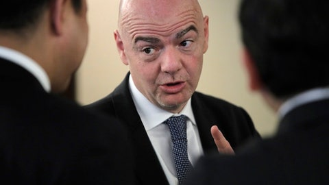FIFA President Gianni Infantino speaks with participants of the Asian Football Confederation (AFC) meeting in Moscow, Russia, Monday, June 11, 2018. (AP Photo/Dmitri Lovetsky)