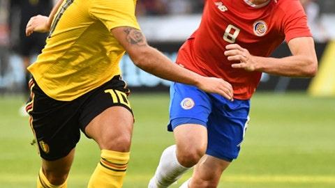 Belgium's Eden Hazard, left, vies for the ball with Costa Rica's Bryan Oviedo during a friendly soccer match between Belgium and Costa Rica at the King Baudouin stadium in Brussels, Monday, June 11, 2018. (AP Photo/Geert Vanden Wijngaert)