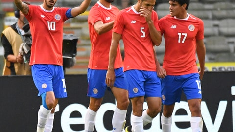 Costa Rica's Bryan Ruiz, left, jubilates with teammate Costa Rica's Bryan Oviedo after scoring his sides first goal during a friendly soccer match between Belgium and Costa Rica at the King Baudouin stadium in Brussels, Monday, June 11, 2018. (AP Photo/Geert Vanden Wijngaert)