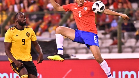 Costa Rica's Oscar Duarte goes up against Belgium's Romelu Lukaku during a friendly soccer match between Belgium and Costa Rica at the King Baudouin stadium in Brussels, Monday, June 11, 2018. (AP Photo/Geert Vanden Wijngaert)