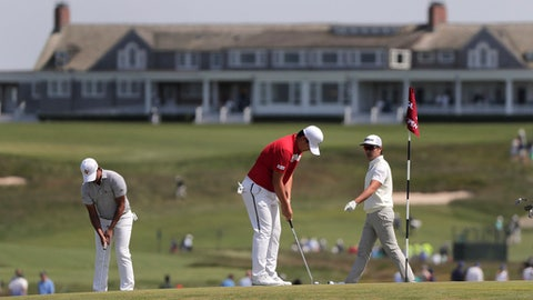 From left, Si Woo Kim, Sungjae Im and Sung Joon Park, all of South Korea, practice putting on the seventh green during a practice round for the U.S. Open Golf Championship, Monday, June 11, 2018, in Southampton, N.Y. (AP Photo/Julie Jacobson)