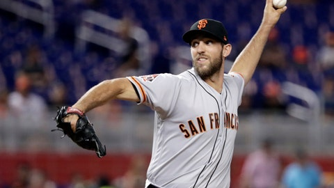 San Francisco Giants starting pitcher Madison Bumgarner delivers during the first inning of a baseball game against the Miami Marlins, Monday, June 11, 2018, in Miami. (AP Photo/Lynne Sladky)