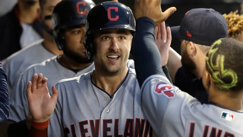 Cleveland Indians' Lonnie Chisenhall, left, celebrates in the dugout after scoring on a double by Yan Gomes during the fourth inning of a baseball game against the Chicago White Sox Monday, June 11, 2018, in Chicago. Melky Cabrera also scored on the play. (AP Photo/Charles Rex Arbogast)