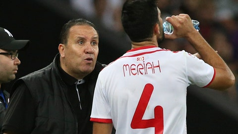FILE- In this Saturday, June 9, 2018 file photo, Tunisia's head coach Nabil Maloul, left, speaks with Tunisia's Yassine Meriah, who drinks water during a friendly soccer match against Spain in Krasnodar, Russia. Ramadan, the holy month that requires Muslims to fast and refrain from drinking or eating anything from sunrise to sunset, has posed serious challenges for some of the teams in their buildup to the World Cup. (AP Photo, File)