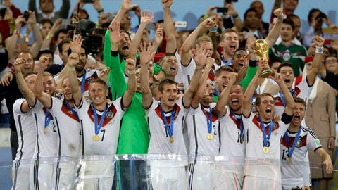 FILE - In this July 13, 2014 file photo Germany's Philipp Lahm holds up the World Cup trophy as the team celebrates their 1-0 victor over Argentina after the World Cup final soccer match between Germany and Argentina at the Maracana Stadium in Rio de Janeiro, Brazil. The soccer world gathers at 12 stadiums in 11 cities across the European portion of Russia starting June 14 for a 32-day, 64-match World Cup. (AP Photo/Natacha Pisarenko)
