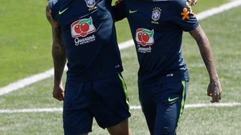 Brazil's Neymar, right, embraces teammate Gabriel Jesus, during a training session in Sochi, Russia, Tuesday, June 12, 2018. Brazil will face Switzerland on June 17 in the group E for the soccer World Cup. (AP Photo/Andre Penner)