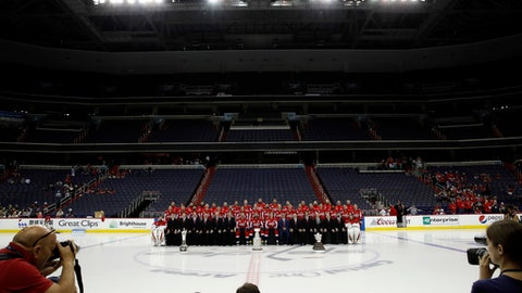 The Washington Capitals NHL hockey team pose for a team picture with the Stanley Cup on the ice at Capital One Arena, Tuesday, June 12, 2018, in Washington. (AP Photo/Alex Brandon)