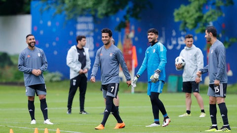 Iran's Masoud Shojaei, second left, trains with his teammates during a training session of Iran at the 2018 soccer World Cup in Moscow, Russia, Tuesday, June 12, 2018. (AP Photo/Hassan Ammar)