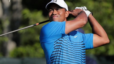 Tiger Woods tees off the fourth hole during a practice round for the U.S. Open Golf Championship, Tuesday, June 12, 2018, in Southampton, N.Y. (AP Photo/Julie Jacobson)