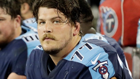 FILE - In this Oct. 16, 2017, file photo, Tennessee Titans' Taylor Lewan sits on the bench during the first half of an NFL football game against the Indianapolis Colts in Nashville, Tenn. The two-time Pro Bowler is skipping the team's mandatory minicamp. The team issued a statement just before the first practice from the general manager saying Lewan's representatives told the team he would not be at camp.  (AP Photo/James Kenney, File)
