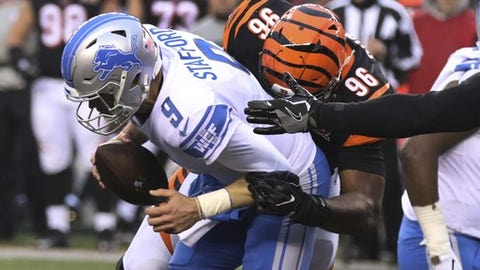 Cincinnati Bengals defensive end Carlos Dunlap (96) sacks Detroit Lions quarterback Matthew Stafford (9) during the second half of an NFL football game, Sunday, Dec. 24, 2017, in Cincinnati. (AP Photo/Gary Landers)