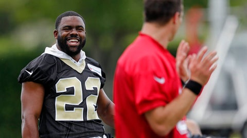 New Orleans Saints running back Mark Ingram (22) talks with quarterback Drew Brees during NFL football practice in Metairie, La., Tuesday, June 12, 2018. (AP Photo/Gerald Herbert)