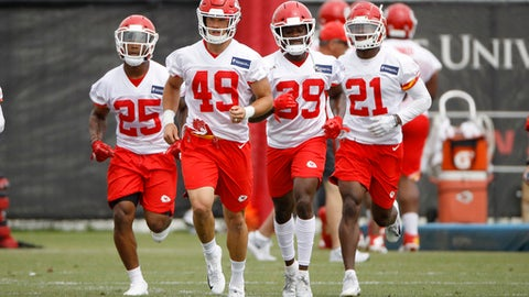 Kansas City Chiefs defensive backs Armani Watts (25), Daniel Sorensen (49), Tremon Smith (39) and cornerback Eric Murray (21) run during the team's NFL football practice Tuesday, June 12, 2018, in Kansas City, Mo. (AP Photo/Charlie Riedel)