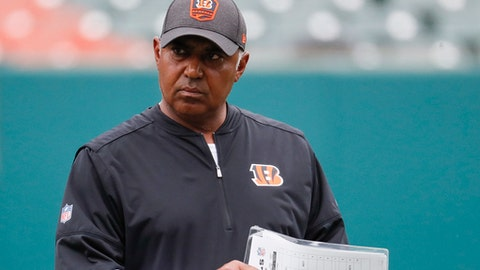 Cincinnati Bengals head coach Marvin Lewis walks the field during practice at the NFL football team's training camp, Tuesday, June 12, 2018, in Cincinnati. (AP Photo/John Minchillo)