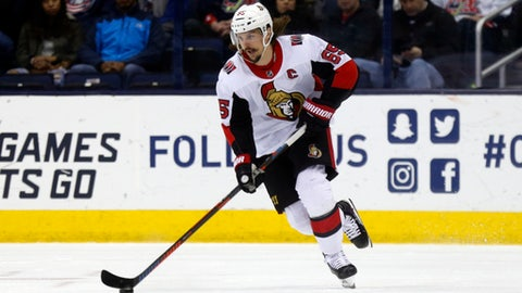 Ottawa Senators defenseman Erik Karlsson, of Sweden, carries the puck against the Columbus Blue Jackets during an NHL hockey game in Columbus, Ohio, Saturday, March 17, 2018. The Blue Jackets won 2-1. (AP Photo/Paul Vernon)