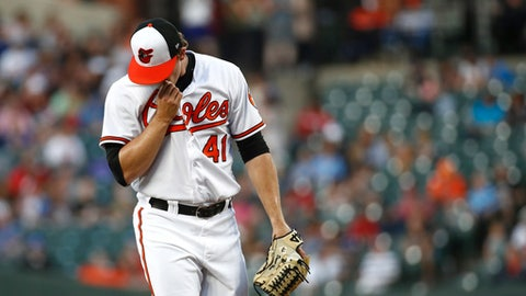 Baltimore Orioles starting pitcher David Hess pauses on the mound after walking Boston Red Sox's Mitch Moreland during the third inning of a baseball game, Tuesday, June 12, 2018, in Baltimore. Hess gave up a run in the third and was relieved in the fourth. (AP Photo/Patrick Semansky)