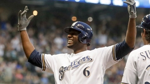 Milwaukee Brewers' Lorenzo Cain reacts after making it back to first on a rundown during the third inning of a baseball game against the Chicago Cubs Tuesday, June 12, 2018, in Milwaukee. (AP Photo/Morry Gash)