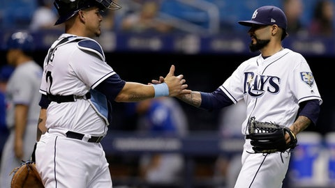 Tampa Bay Rays pitcher Sergio Romo and catcher Wilson Ramos celebrate after the Rays defeated the Toronto Blue Jays 4-1 in a baseball game Tuesday, June 12, 2018, in St. Petersburg, Fla. (AP Photo/Chris O'Meara)