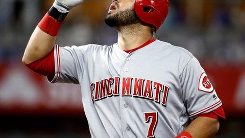 Cincinnati Reds' Eugenio Suarez celebrates on first base after hitting an RBI single during the 10th inning of a baseball game against the Kansas City Royals on Tuesday, June 12, 2018, in Kansas City, Mo. The Reds won 5-1 in 10 innings. (AP Photo/Charlie Riedel)