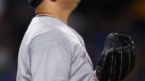 Texas Rangers starting pitcher Bartolo Colon tosses the ball after giving up an RBI single to Los Angeles Dodgers' Chris Taylor during the fourth inning of a baseball game Tuesday, June 12, 2018, in Los Angeles. (AP Photo/Jae C. Hong)