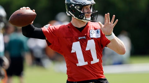 FILE - In this Thursday, June 7, 2018, file photo, Philadelphia Eagles' Carson Wentz runs a drill during an organized team activity at the NFL football team's practice facility, in Philadelphia. Wentz was having an MVP season before a torn ACL forced him to the sideline where he watched Nick Foles lead the Philadelphia Eagles to their first Super Bowl victory. His friendship with Super Bowl MVP Nick Foles appears without the strain seen in other famed NFL tandems.  (AP Photo/Matt Slocum, File)