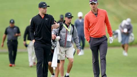 Harry Ellis, left, and Justin Rose, both of England walk up the 12th fairway during a practice round for the U.S. Open Golf Championship, Wednesday, June 13, 2018, in Southampton, N.Y. (AP Photo/Carolyn Kaster)