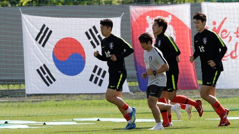 South Korea's Son Heung-min, left, runs during a training session of South Korea at the 2018 soccer World Cup at the Spartak Stadium in Lomonosov near St. Petersburg, Russia, Wednesday, June 13, 2018. (AP Photo/Lee Jin-man)