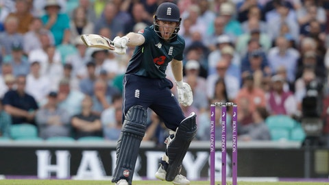 England captain Eoin Morgan shouts to his batting partner Joe Root not to run during the one-day cricket match between England and Australia at the Oval cricket ground in London, Wednesday, June 13, 2018. The game is the first of a five match one-day series between the two sides. (AP Photo/Matt Dunham)