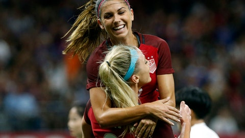 FILE - In this Oct. 19, 2017, file photo, U. S. midfielder Julie Ertz (8) celebrates her header goal with forward Alex Morgan, rear, in the first half of an international friendly women's soccer match against South Korea in New Orleans. Shes already an internationally recognized soccer player with a World Cup title and an Olympic gold medal. Shes also the author of a series of kids books. Now you can add actor to Alex Morgans resume. The U.S. national team forward makes her theatrical debut in a new feature Alex & Me about a young player who is inspired by Morgan.  (AP Photo/Gerald Herbert)