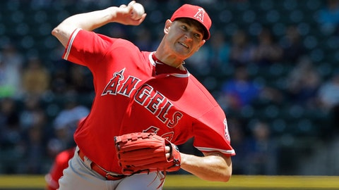 Los Angeles Angels starting pitcher Garrett Richards throws against the Seattle Mariners during the first inning of a baseball game, Wednesday, June 13, 2018, in Seattle. (AP Photo/Ted S. Warren)