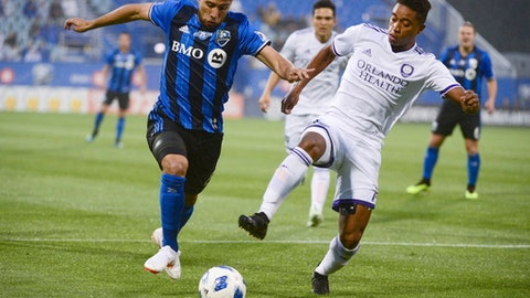 Montreal Impact midfielder Saphir Taider, left, and Orlando City midfielder Cristian Higuita vie for the ball during the first half of an MLS soccer match Wednesday, June 13, 2018, in Montreal. (Paul Chiasson/The Canadian Press via AP)