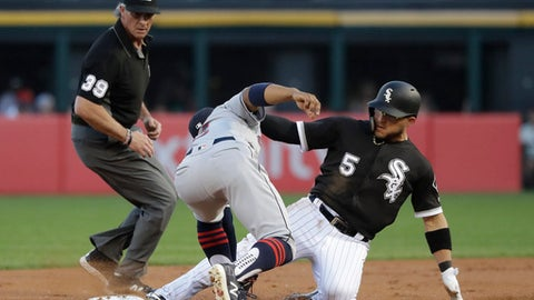 Chicago White Sox's Yolmer Sanchez (5) steals second on a throw from Cleveland Indians catcher Roberto Perez to shortstop Francisco Lindor, as second base umpire Paul Nauert watches during the first inning of a baseball game Wednesday, June 13, 2018, in Chicago. The call was upheld after video review. (AP Photo/Charles Rex Arbogast)