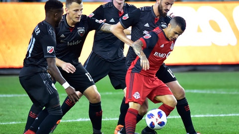 Toronto FC forward Sebastian Giovinco controls the ball as D.C. United's Oniel Fisher, Frederic Brillant, Chris Durkin and Steve Birnbaum, from left, try to box him in during the first half of an MLS soccer match Wednesday, June 13, 2018, in Toronto. (Frank Gunn/The Canadian Press via AP)