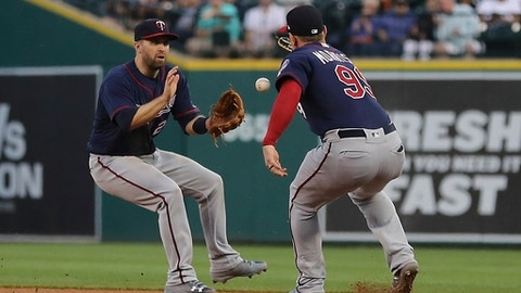 A single hit by Detroit Tigers' Leonys Martin falls between Minnesota Twins second baseman Brian Dozier, left, and first baseman Logan Morrison (99) during the fifth inning of a baseball game, Wednesday, June 13, 2018, in Detroit. (AP Photo/Carlos Osorio)