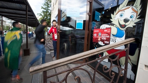 Soccer fans from different countries gather at the main ticket office in Moscow, Russia, Thursday, June 14, 2018. Scalpers are still very visible at the World Cup, despite FIFA and Russia's claims they've cracked down on illicit ticket sales. (AP Photo/Alexander Zemlianichenko)