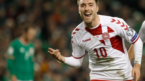 FILE - In this Nov. 14, 2017, file photo, Denmark's Christian Eriksen celebrates after scoring his side's third goal during the World Cup qualifying second leg soccer match against Ireland in Dublin, Ireland. Led by explosive star Tottenham Hotspur midfielder Christian Eriksen, the Danish Dynamite responded with six victories and three ties during their final nine qualifiers. That run included a 4-0 rout of qualifying group-winner Poland and a 5-1 demolition of Ireland in the second leg of a two-game playoff to secure a fifth World Cup appearance and first since 2010. (AP Photo/Peter Morrison, File)