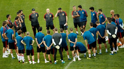 Spain head coach Fernando Hierro, top centre, touches his forehead as gives instructions to his players during Spain's official training on the eve of the group B match between Portugal and Spain at the 2018 soccer World Cup in the Fisht Stadium in Sochi, Russia, Thursday, June 14, 2018. (AP Photo/Francisco Seco)