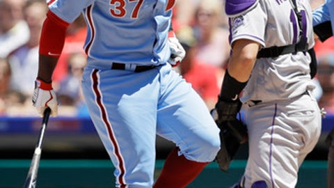 Philadelphia Phillies' Odubel Herrera, left, hops off after fouling a pitch off his foot during the fourth inning of a baseball game, Thursday, June 14, 2018, in Philadelphia. At right is catcher Tony Wolters. (AP Photo/Matt Slocum)