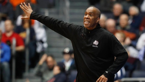 FILE - In this March 14, 2018. file photo, Texas Southern coach Mike Davis gestures during the first half of a First Four game of the NCAA men's college basketball tournament against North Carolina Central in Dayton, Ohio. Detroit Mercy has hired Davis away from Texas Southern. The Horizon League school announced the move Thursday, June 14, adding a coach with a 352-241 career record in college. (AP Photo/John Minchillo, File)
