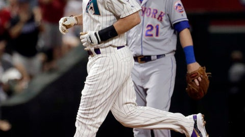 Arizona Diamondbacks' Paul Goldschmidt rounds the bases after hitting a solo home run as New York Mets' Todd Frazier (21) watches during the third inning of a baseball game Thursday, June 14, 2018, in Phoenix. (AP Photo/Matt York)
