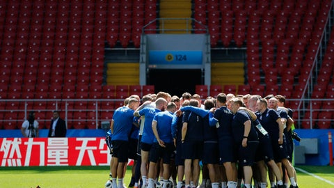 Players and staff huddle up at the start of Iceland's official training session on the eve of the group D match between Argentina and Iceland at the 2018 soccer World Cup in Spartak Stadium in Moscow, Russia, Friday, June 15, 2018. (AP Photo/Rebecca Blackwell)